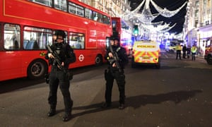 Armed police in Oxford Street, London, on Friday, 24 November.