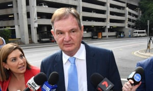 Former Ipswich mayor Paul Pisasale (centre) arrives at the Brisbane magistrates court in in August.