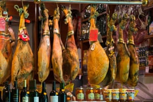 Serrano Ham and Jamon Iberico hanging in a shop in Barcelona in Spain.