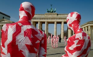 """Berlin, Germany. Mannequins wrapped in tape stand in front of the city's Brandenburg Gate as part of artist Dennis Josef Meseg's Corona Memorial """"It is Like it is"""""""