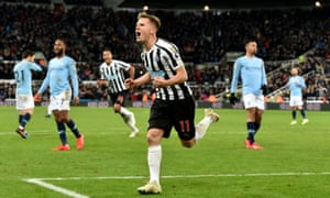 Matt Ritchie of Newcastle United celebrates after scoring his team's second goal.