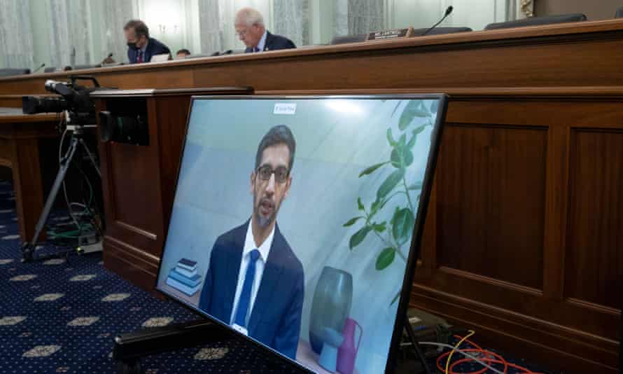 Sundar Pichai, CEO of Google, appears on a monitor as he testifies remotely before senators this week.