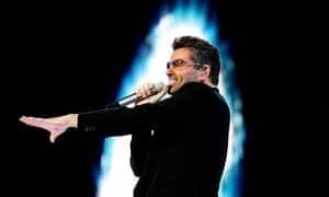 George Michael singing on stage.