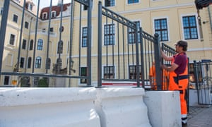 Workers erect a barricade outside the Taschenbergpalais hotel in Dresden