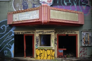 The old cinema shows graffiti by tresspassers