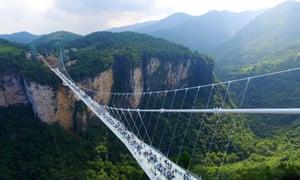 The Zhangjiajie Grand Canyon's glass-bottomed bridge opened on Saturday.