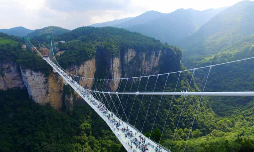 The Zhangjiajie Grand Canyon's glass-bottomed bridge opened on Saturday.