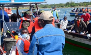 Rescuers search for bodies off the shores of Ukerewe Island on Lake Victoria.