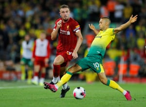 Liverpool's Jordan Henderson is fouled by Norwich City's Moritz Leitner.