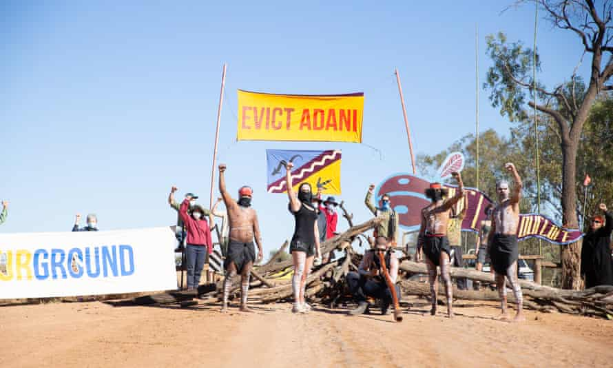 Protestors at the Adani mine site in Queensland last August. Adani said a federal court ruling on Tuesday over its use of water 'will not have any impact on the construction or operation of the Carmichael mine'.
