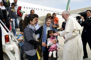 Pope Francis welcomes a group of Syrian refugees to Rome