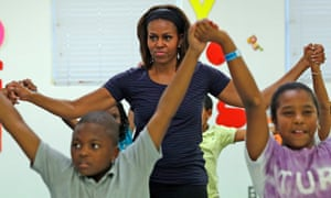 """First lady Michelle Obama in a yoga session for her """"Let's Move"""" campaign last year."""