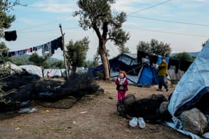 A child stands in a makeshift camp adjacent to the Moria camp for refugees and migrants on the island of Lesbos.