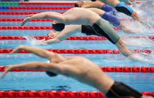 Great Britain's Stephen Clegg (in red cap) enters the pool at the start of the men's 100m backstroke S12 final.