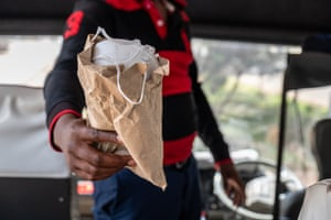 Peter hands out face masks in Nairobi