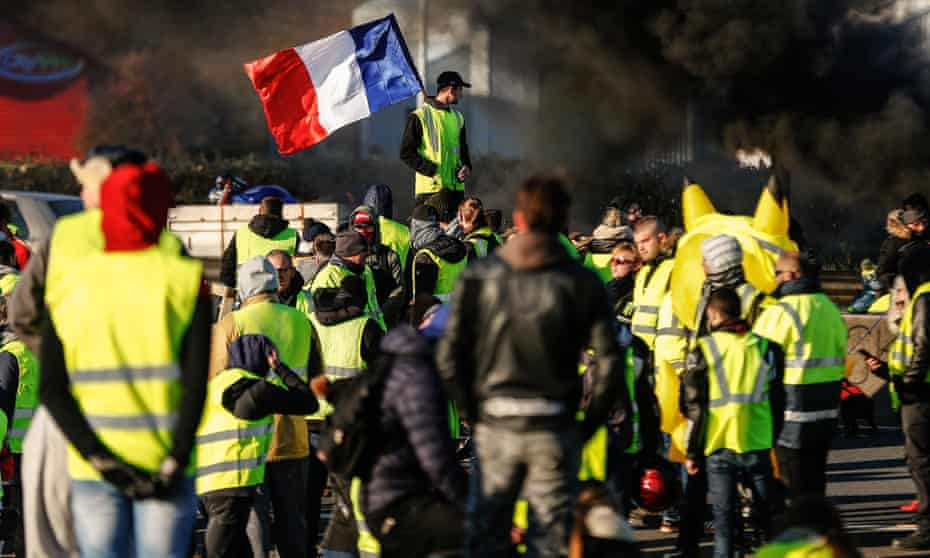 Protesters block a road in Caen