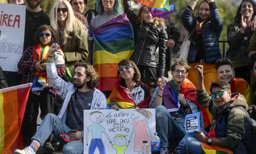 People in Bucharest protest against proposed changes to the constitution that they say would prevent future recognition of same-sex marriages in Romania.