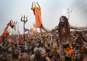 Hindu holy men walk in a procession towards the Sangam during the auspicious bathing day