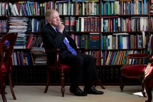 Michael Kirby surrounded by books