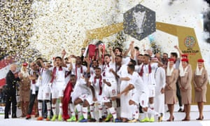 Qatar's Hasan Al Haydos lifts the trophy as they celebrate winning the Asian Cup.