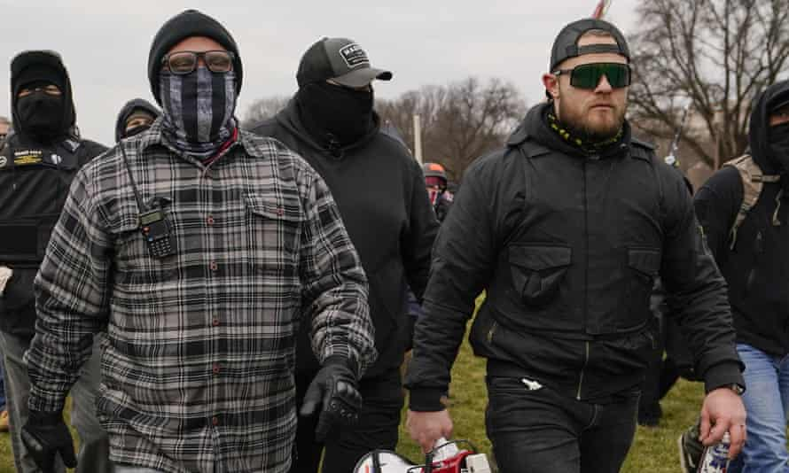 Proud Boys leaders Joseph Biggs, left, and Ethan Nordean, right, walk towards the US Capitol on 6 January.