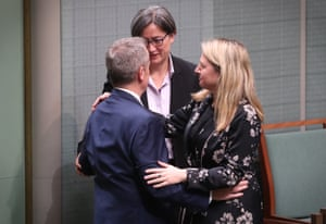The opposition leader, Bill Shorten, hugs Louise Pratt and Penny Wong in the chamber this morning