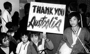 Young Vietnamese child holds up a sign, 'Thank you Australia'