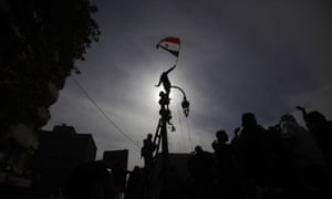 An Egyptian protestor climbs a pole waving his national flag during a demonstration in Tahrir Square, Cairo, Egypt. (AP Photo/Nathalie Bardou)