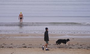 A swimmer walks into the water at Mentone Beach in Melbourne, Australia, 5 May 2020.