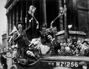 Members of the Auxiliary Territorial Service in their service vehicle, driving through Trafalgar Square during the VE Day celebrations in London