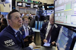 Specialist Frank Masiello, left, working at his post on the floor of the New York Stock Exchange today.