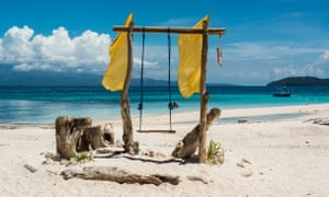 Wooden swing on the beach of a tropical paradise island. Yoga Scuba, Phillipines with Recconect Discover