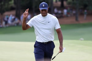 Tiger celebrates a birdie on the 9th.