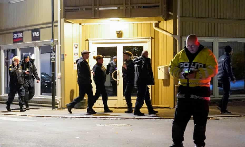 Police officers investigate at the scene after a bow and arrow attack killed five people in Norway.