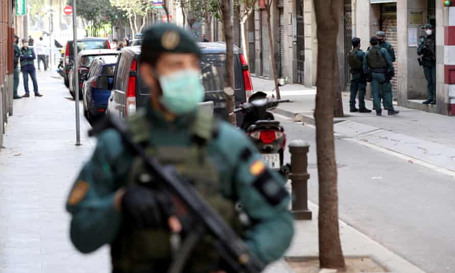 A police officer stands guard at the scene of the arrest in Barcelona