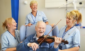 A patient playing the violin