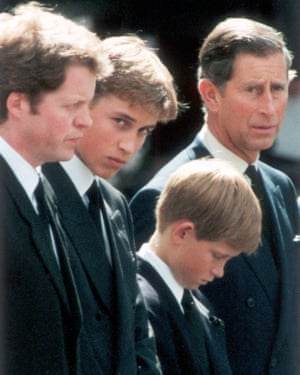 Earl Spencer, Prince William, Prince Harry and Prince Charles wait as the hearse carrying the coffin of Diana, Princess of Wales, prepares to leave Westminster Abbey following her funeral service on 6 September 1997.