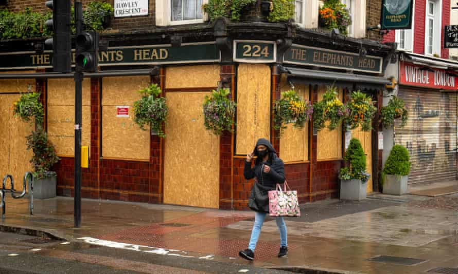 A London pub boarded up during the lockdown.