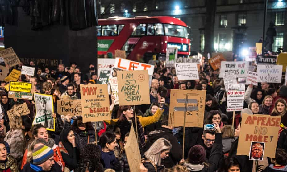 Demonstrators near Downing Street protest against the UK government's close links with the Trump administration