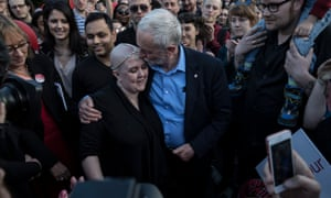 Corbyn embraces a supporter at a rally in Sheffield.