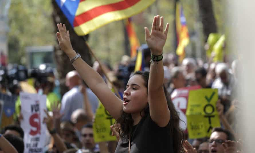 A Catalonia independence flag flies during a protest in Barcelona after police arrested a top official in the region's economic affairs office.