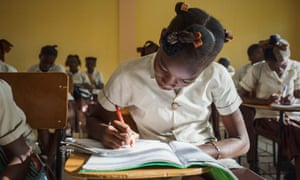 Students attend class at the Academy of Peace and Justice in Port-Au-Prince.