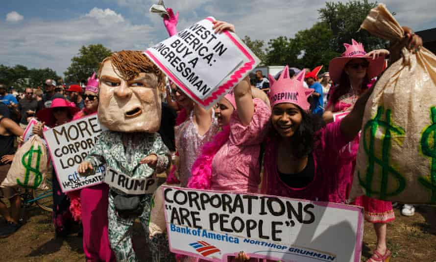 Activists with Code Pink protest against Donald Trump and corporations before a Prophets of Rage pop-up concert.
