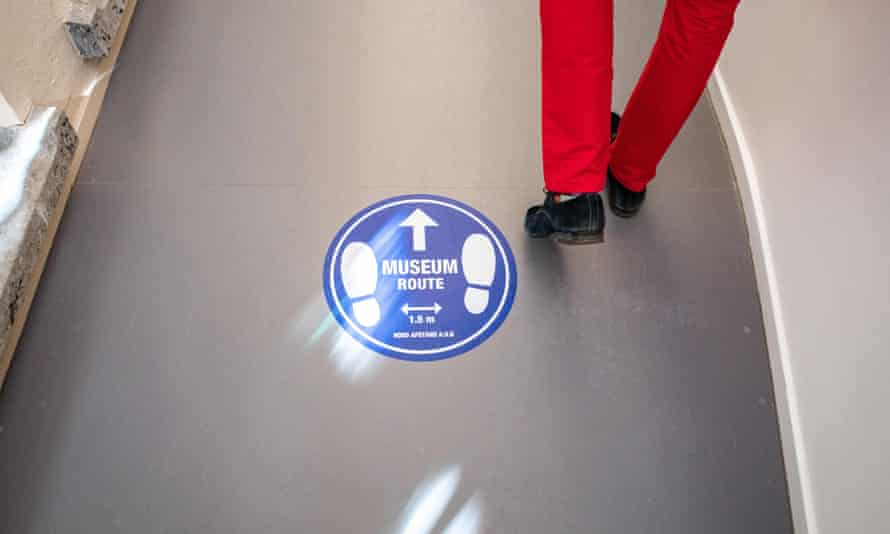 A man walks past a sign at the Fundatie museum in Zwolle