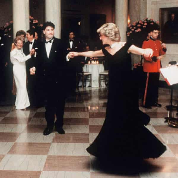 Last great silent movie star … Princess Diana dances with John Travolta at the Reagan White House in 1985, as President Ronald Reagan looks on.