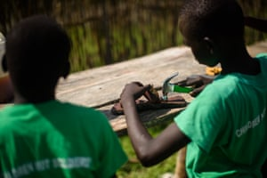 Boys take part in a leatherwork skills session at the Pibor youth centre.