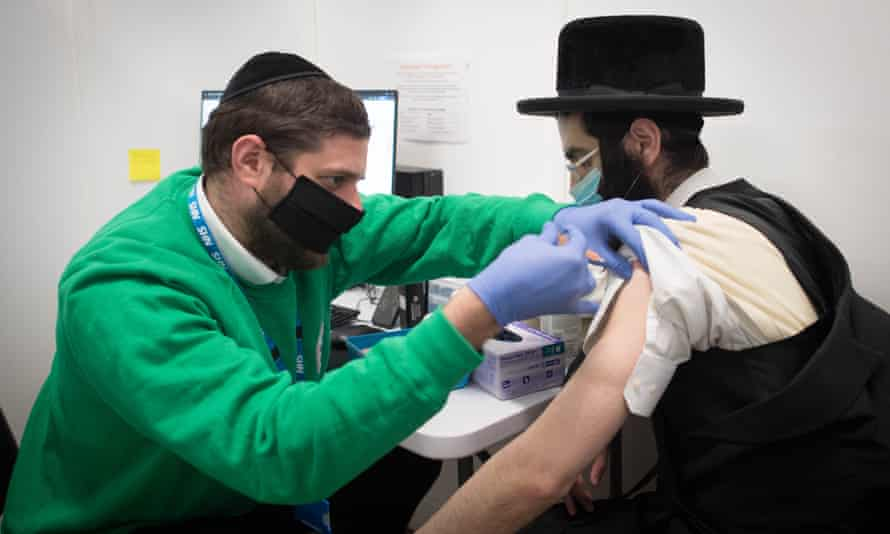 A man receives his Covid-19 vaccination at the John Scott vaccination centre in north London.