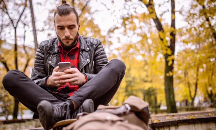 man browsing phone