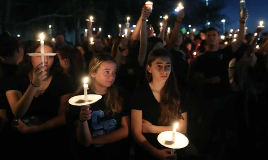 Students and family members attend a vigil for victims of the mass shooting at Marjory Stoneman Douglas high school in Parkland, Florida, on 15 February 2018.