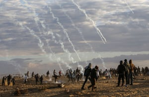 Tear gas is are fired by Israeli forces at Palestinian protesters at the  Israel-Gaza border.